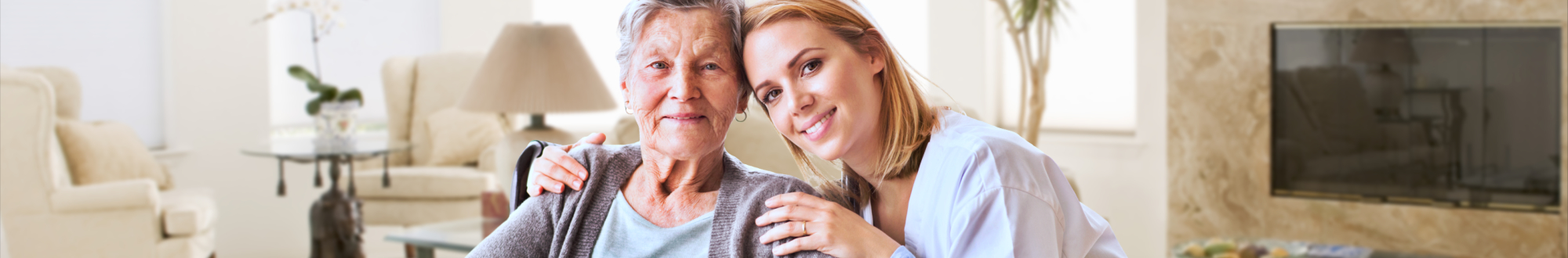caregiver hugging elderly woman