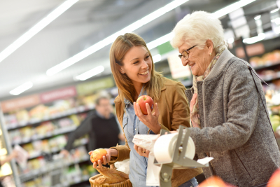 Elderly woman with her caregiver at the grocery store